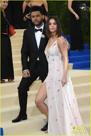 selena gomez embraces the weeknd during their red carpet debut at