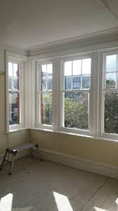 pictures of houses with shutters on some windows heritance in