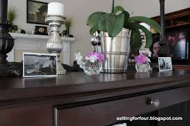 how to style a sofa table and define your living room setting