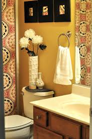 cool bathroom with cute light green accents curtain pattern and marvelous yellow wall paint of elegant bathroom idea feat white toilet units and sweet flower vase