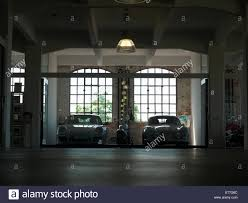 porsche 911 porsche 356 and a harley davidson parking in a loft