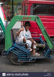 tricycle philippines filipino tricycle driver manila philippines stock photo royalty
