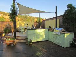 outdoor kitchen cabinet doors shabby chic inspired outdoor bar bbq set up with reclaimed