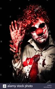 halloween clown background horror clown waving chopped off hand to welcome you to a evil