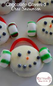 chocolate covered oreo cookie snowmen treats for a winter fun treat