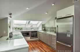 7 gorgeous non white kitchen designs in a small kitchen design wood grain cabinetry creates a focal point but doesn t overwhelm the space