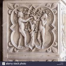 relief carving of adam eve and the tree of knowledge eve eats an