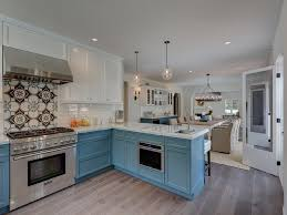 white cabinets on top blue on bottom white top cabinets and blue bottom cabinets transitional