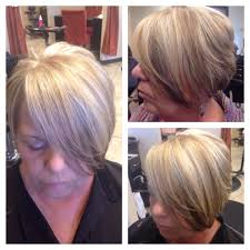 asymmetrical haircut with a blonde base platinum highlights