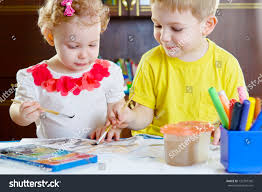 cute little brother sister painting home stock photo 132797342