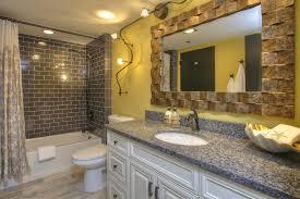 catchy tropical bathroom lighting bathroom track lighting bathroom tropical with bathroom condo