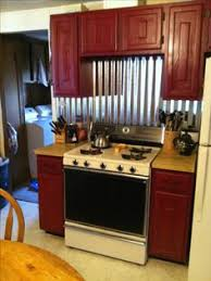 backsplash in kitchens old barn tin that we used as back splash in kitchen behind sink and
