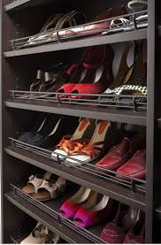 neatly shoe storage units integrated with hanging clothes