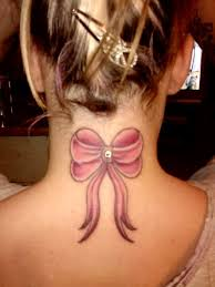 breast dermal piercing of bow tattoo with dermal anchor