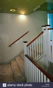 beige shag pile carpet on staircase with white banisters and