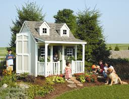 backyard cottage playhouse with front porch dormers and loft