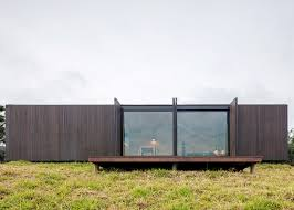 mapa builds two prefabricated houses in brazilian mountain