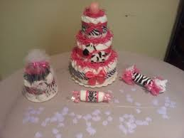 baby shower cake decorations for a pink zebra diaper cake