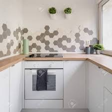 kitchen with white cabinets and wood countertops kitchen in nordic style with white cabinets wooden countertop