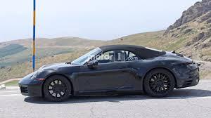 blue porsche convertible next gen porsche 911 cabriolet spied enjoying mountain roads