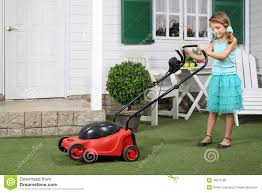 happy cute little with red lawn mower stock photography