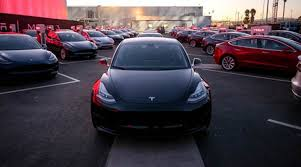 tesla delivers first lower cost model 3 cars the indian express