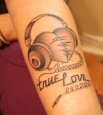 with headphones tattoo on back tattoomagz
