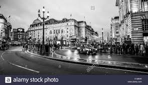 wide angle view over piccadilly circus in london at christmas time