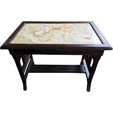 aesthetic movement ebonized center table with figurative marble