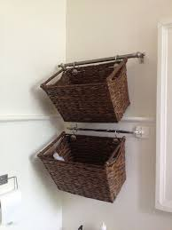 Wicker Bathroom Storage by Using Shower Hooks To Hang Decorative Baskets From The Towel Racks