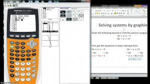 how to solve systems using the graphing calculator