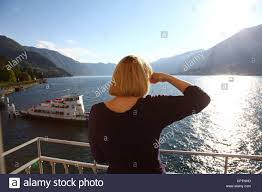 a woman on her hotel balcony sheilding her eyes from the setting