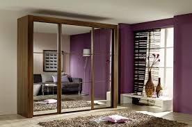 walnut wood closet in brown finish for small bedroom with sliding