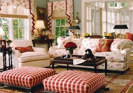 country living room designs with floral sofa and ottomans and