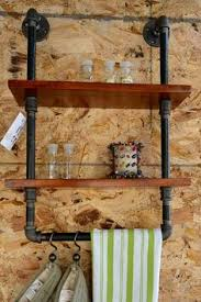 Black Pipe Shelving by 20 Diy Shelving Ideas Racks And Wall Shelves Created With Metal