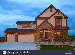 Colorado House by Middle Class Home Exterior At Dusk Denver Colorado Stock Photo