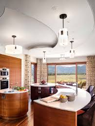decorative drum pendant lamps set above vintage kitchen interior