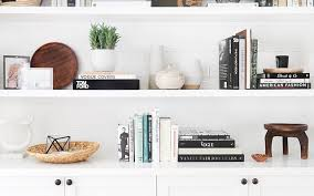 how to decorate a bookshelf how to decorate shelves like a home decor pro stylecaster