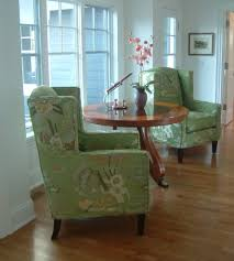 modern wingback chair living room traditional with green pair