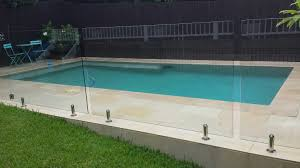 Landscaping Around Pools by Sawn And Sandblasted Sandstone Paving And Coping Around Pool