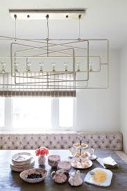 currey and co metro rectangular chandelier with pink tufted dining