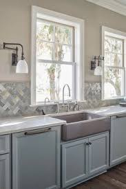 Tile Backsplash For Kitchen by White Ceramic Subway Tile Apron Sink Gray Cabinets And Grey