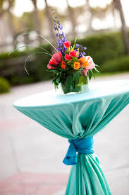 cocktail table centerpieces bring color to cocktail hour with turquoise cocktail table linens