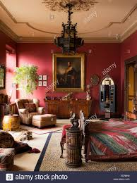 large red bedroom with leopard print carpet gilt framed portrait