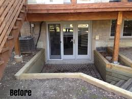 basement walkout deck with walkout basement in a hill search landscape