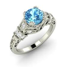 topaz engagement ring claudine engagement ring with blue topaz si diamond 0 95