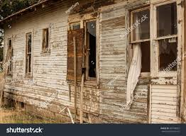 weathered boards peeling paint on side stock photo 205748023