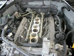 nissan 350z oil change replacing the spark plug well seals in the valve covers