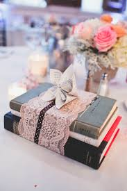 perfect centerpieces for a vintage book theme wedding wedding