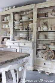 i love all the white ironstone in this hutch antique white